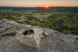 Photo of Independence Headwaters Ranch, sunrise over rock ledge and boulders